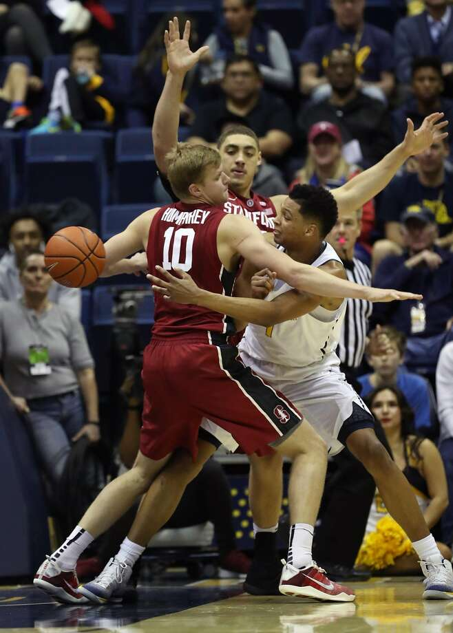 California's Ivan Rabb passes around defense of Stanford's Michael Humphrey (10) and Reid Travis in 2nd half during Cal's 66-55 win in Pac 12 basketball game at Haas Pavilion in Berkeley, Calif., on Sunday, January 29, 2017. Photo: Scott Strazzante, The Chronicle