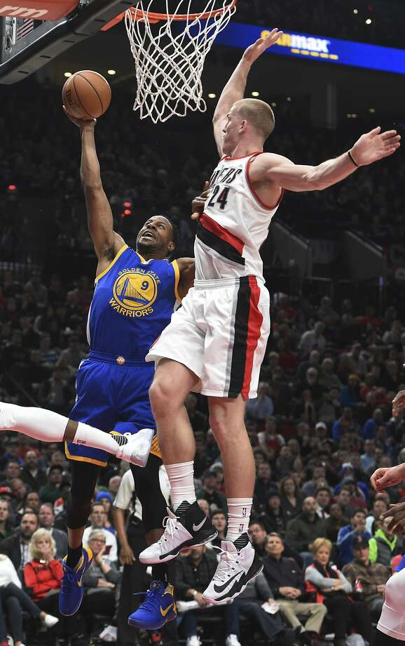 Golden State Warriors forward Andre Iguodala drives to the basket on Portland Trail Blazers center Mason Plumlee during the first half of an NBA basketball game in Portland, Ore., Sunday, Jan. 29, 2017. (AP Photo/Steve Dykes) Photo: Steve Dykes, Associated Press