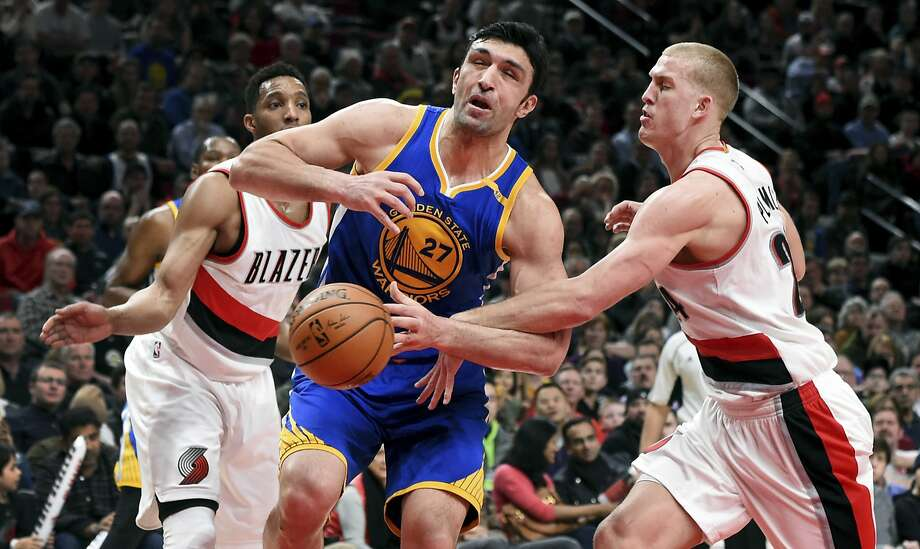 Golden State Warriors center Zaza Pachulia is fouled by Portland Trail Blazers center Mason Plumlee as he drives to the basket during the first half of an NBA basketball game in Portland, Ore., Sunday, Jan. 29, 2017. (AP Photo/Steve Dykes) Photo: Steve Dykes, Associated Press