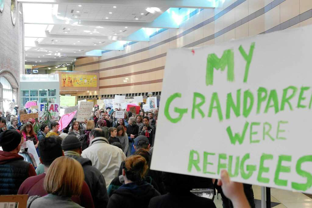 Image result for protests against muslim ban  albany airport times union