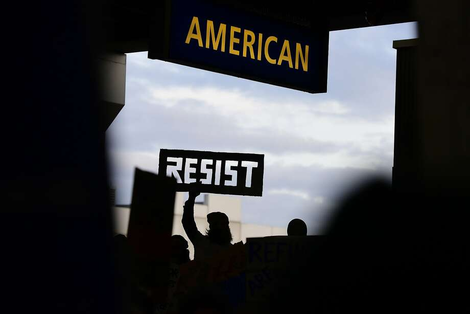 A protester holds up a cutout sign during a protest of President Donald Trump's executive order banning travel to the U.S. by citizens of Iraq, Syria, Iran, Sudan, Libya, Somalia or Yemen Sunday, Jan. 29, 2017, at Philadelphia International Airport in Philadelphia. Photo: Corey Perrine, Associated Press