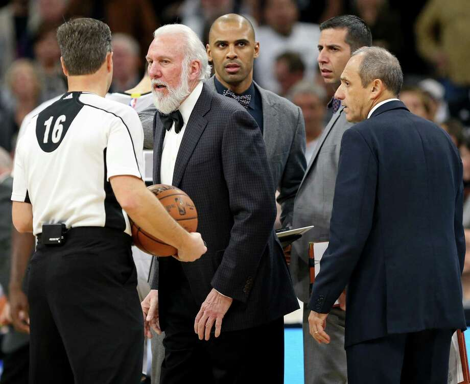 Spurs coach Gregg Popovich talks with an official as assistant coaches Ime Udoka (from left), James Borrego and Ettore Messina listen. Photo: Edward A. Ornelas /San Antonio Express-News / © 2017 San Antonio Express-News
