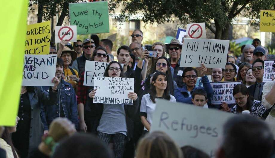 Move San Antonio supporters participate in a rally at San Fernando Cathedral to protest President Donald Trump's executive order against people from Muslim-majority countries. Photo: Photos By Ron Cortes /For The San Antonio Express-News / Freelance