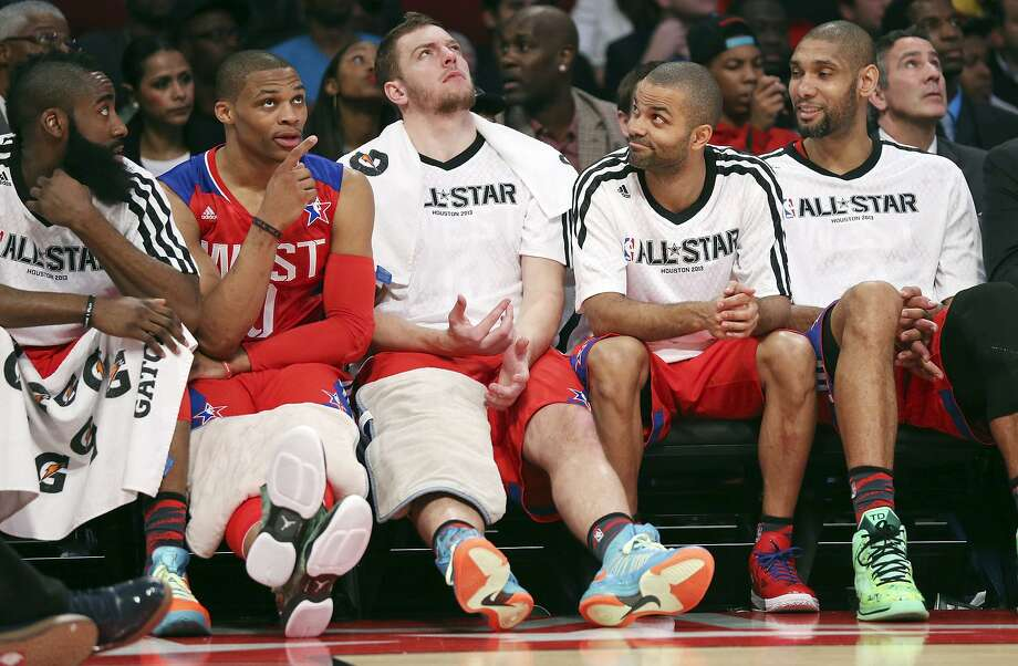 West's James Harden (from left), Russell Westbrook, David Lee, Tony Parker and Tim Duncan sit on the bench during first-half action of the 62nd NBA All-Star Game at the Toyota Center on Feb. 17, 2013 in Houston. Photo: Edward A. Ornelas /San Antonio Express-News / © 2013 San Antonio Express-News