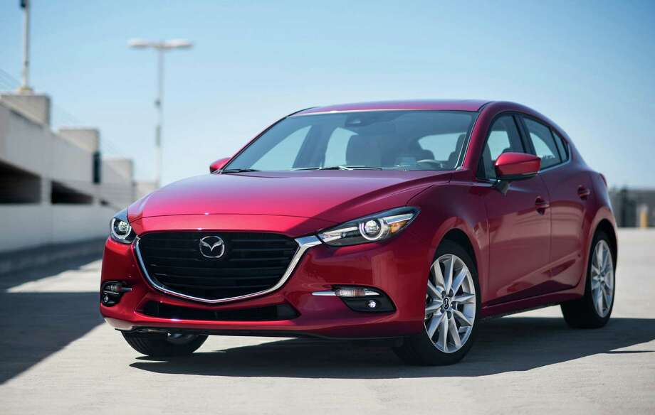 For 2017, every Mazda3 5-door, except the base Sport trim, gets new side mirrors and 18-inch alloy wheels. Photo: Mazda / © Morgan J Segal Photography -All Rights Reserved.