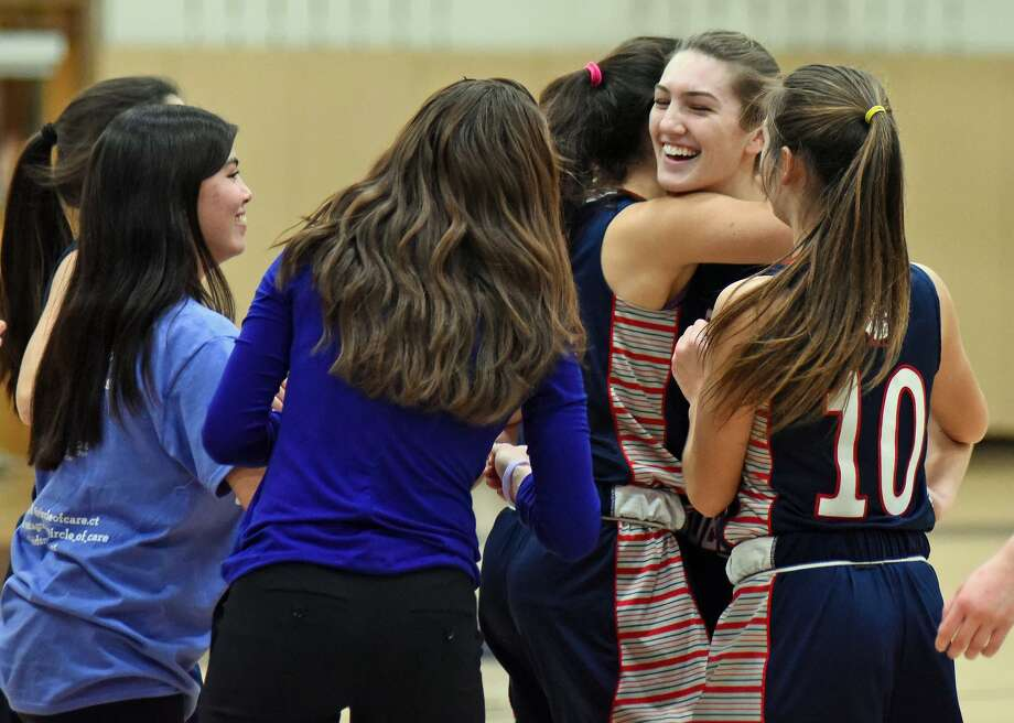 Greens Farms Academy senior Lexi Kimball of Easton is congratulated by her teammates and coaches as she became the school's all-time leading scorer for both boys and girls. In a loss against Cheshire Academy, Kimball's 27 points put her career scoring total at 1,377. Photo: Contributed / Photo