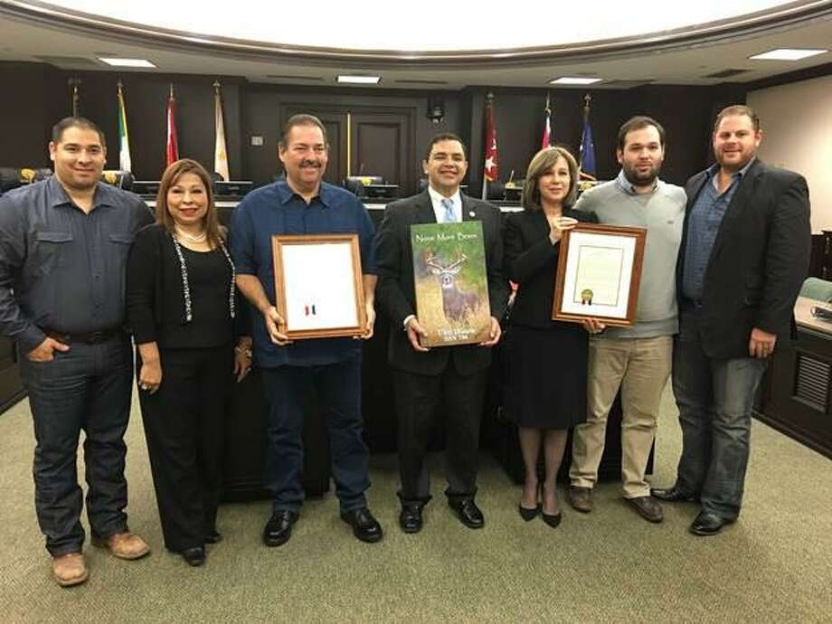 """Congressman Cuellar honors the family of the late John McKeown, a U.S. Navy and Korean War veteran, and professional photographer Fidel """"Butch"""" Ramirez during a ceremony at Laredo City Hall on Thursday. Pictured from left are Tony Ramirez, Zita Ramirez, Fidel Ramirez, Cuellar, Carolyn McKeown, Eduardo Hinojosa Jr. and Ari Hoffman. Photo: Courtesy"""