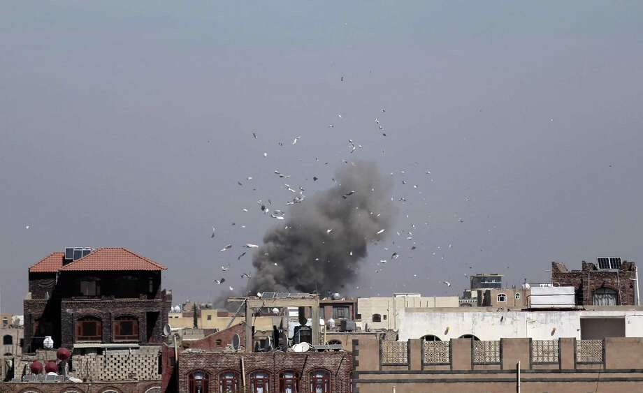 Debris and smoke rise after a Saudi-led airstrike hit an army base, in Sanaa, Yemen, Sunday, Jan. 22, 2017. (AP Photo/Hani Mohammed) Photo: Hani Mohammed, STR / Associated Press / Copyright 2017 The Associated Press. All rights reserved.