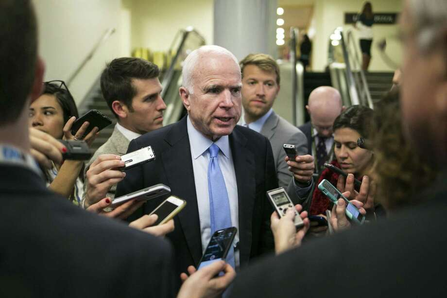 FILE -- Sen. John McCain (R-Ariz.) talks to reporters after leaving the Senate floor, on Capitol Hill in Washington, Jan. 5, 2017. Trump's executive order halting entry to the U.S. of Syrian refugees and all travelers from several predominantly Muslim countries drew criticism from several prominent Republican senators, including Sens. Lindsey Graham of South Carolina, Rob Portman of Ohio and McCain. (Al Drago/The New York Times) Photo: AL DRAGO, STF / NYT / NYTNS