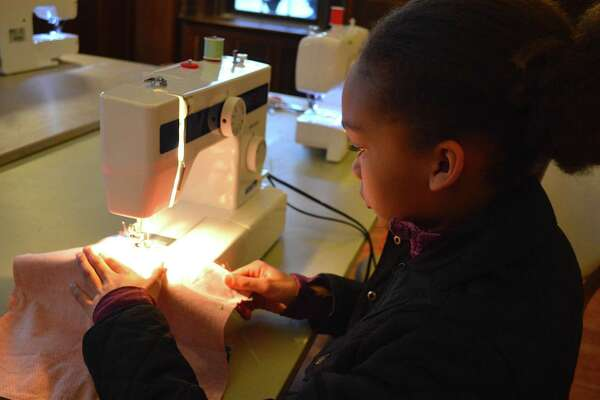Chloe Oiekanmi, 10, of New Canaan, uses a real sewing machine at a new weekly sewing class offered through the Recreation Department and New Canaan Library, held at Waveny House, Wednesday, Jan. 25, 2017, in New Canaan, Conn.