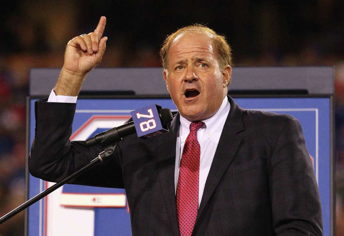 FILE - In this Sept. 15, 2016, file photo, Chris Berman introduces former Buffalo Bills Hall of Fame defensive end Bruce Smith during his jersey retirement ceremony at halftime of an NFL football game, in Orchard Park, N.Y. Berman isn't disappearing from in front of the cameras or from behind the microphones. He's simply stepping to the side a bit. The longtime ESPN fixture is giving up his regular on-air NFL and baseball spots for a new role at the network.(AP Photo/Bill Wippert, File)