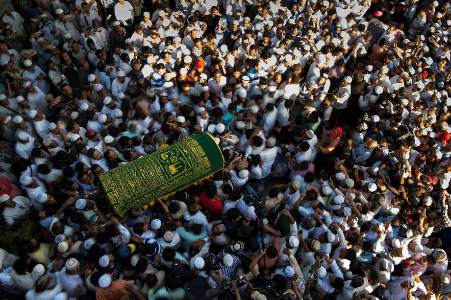 Mourners carry the coffin of Ko Ni, a prominent Muslim lawyer, in Yangon, Myanmar. Photo: YE AUNG THU, AFP/Getty Images