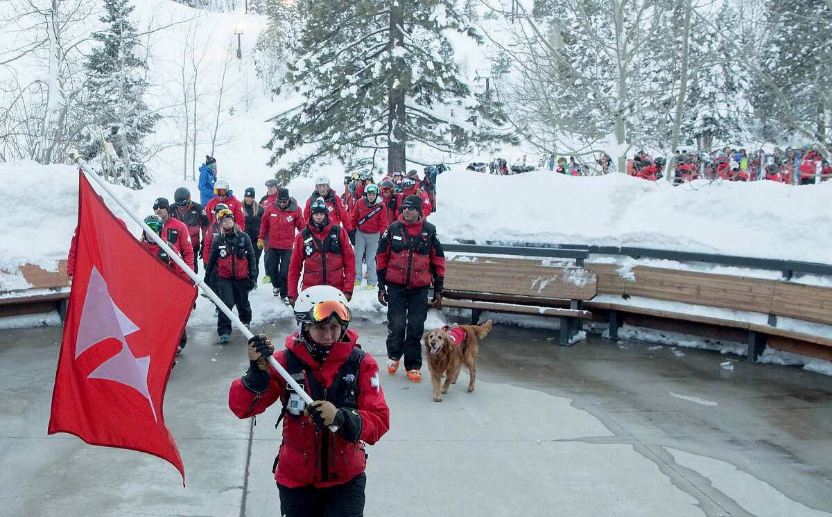 Ski Patrolmen from around the country arrive at a memorial after skiing down a mountain at Squaw Ski Resort in North Lake Tahoe, California on January 27, 2017. On Tuesday, Joe Zuiches, a ski safety patroller, was killed from a hand-charge explosion during avalanche control activities at Squaw Valley ski resort, the third explosive-caused avalanche death in 43 years.