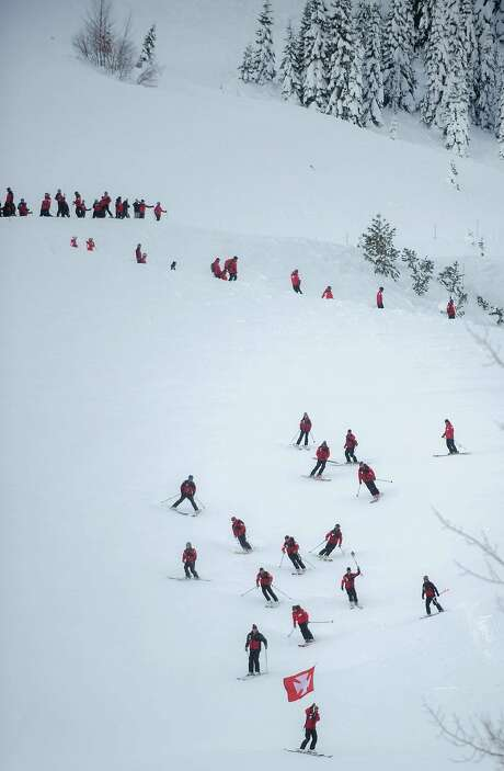Ski patrollers from around the country ski down a mountain as part of a memorial on Friday for Joe Zuiches at Squaw Ski Resort in North Lake Tahoe. Photo: JOSH EDELSON, JOSH EDELSON / SAN FRANCISCO CHR