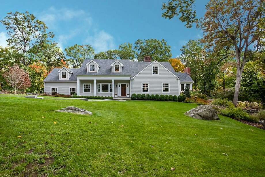 The Cape Cod-style house at 10 Winding Lane sits on a level and sloping property of just over one acre not far from local beaches, shops, restaurants and the train station.