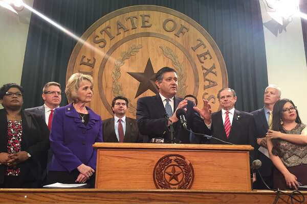 State Rep. Richard Pena Raymond, D-Laredo, and other lawmakers in a legislative working group unveil their plans to improve Child Protective Services and the state's foster care system at a press conference at the state Capitol on Jan. 30, 2017.
