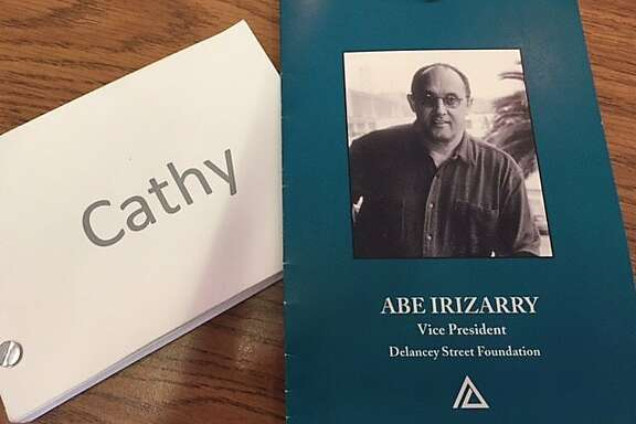 Memorial programs for Cathy Topham and Abe Irizarry