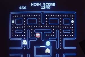 """FILE - In this 1983 file photo, this close up view of a monitor shows the electronic video game Pac-Man. Masaya Nakamura, the """"Father of Pac-Man"""" who founded the Japanese video game company behind the hit creature-gobbling game, died on Jan. 22, 2017. He was 91. (AP Photo)"""
