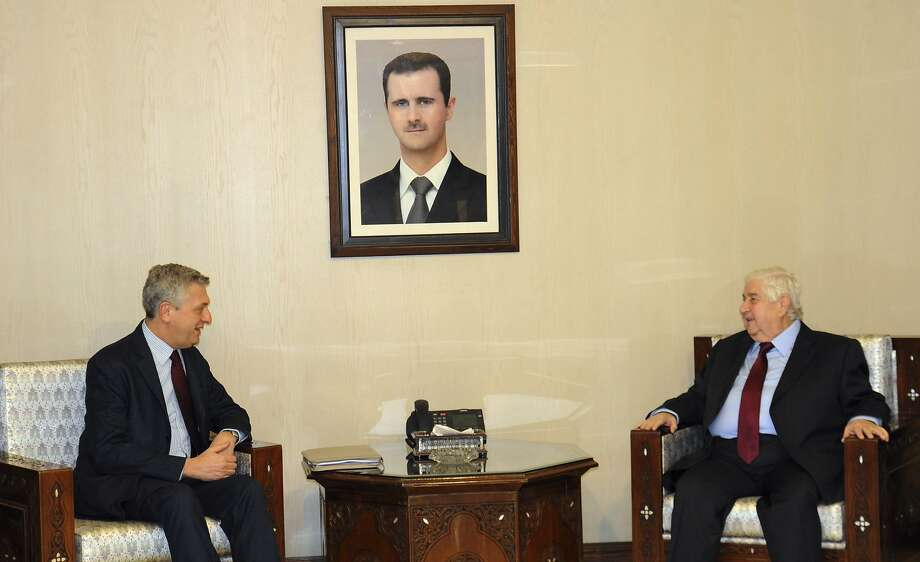 The head of the U.N. refugee agency, Filippo Grandi (left), meets with Syrian Foreign Minister Walid al-Moallem in Damascus. Safe zones are seen as a threat to Syrian sovereignty. Photo: Uncredited, Associated Press