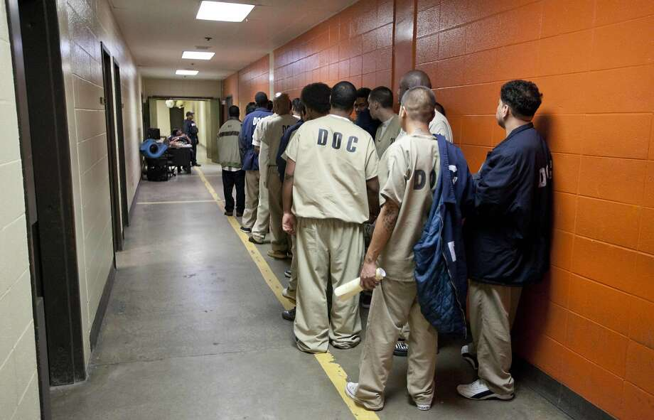 Inmates line up at the Cook County Jail in Chicago in 2011. Community activists have started bail funds to get people out of jails. Photo: M. Spencer Green, Associated Press