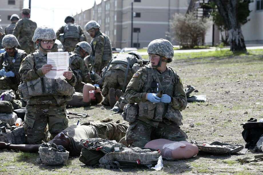 U.S. Army medics in training Pvt. 2 Erin Owens, left, 19, of St. Marys, Ohio and Pfc. Beth Minyard, 19, of Benton, Arkansas, go through an exercise at Joint Base San Antonio-Fort Sam Houston, Tuesday, Jan. 24, 2017. Former President Obama's initiative to open up the last combat specialties that have long been closed to women could be in jeopardy now that retired Marine Gen. James Mattis is likely to become the next defense secretary under President-elect Donald Trump. Photo: JERRY LARA /San Antonio Express-News / © 2017 San Antonio Express-News
