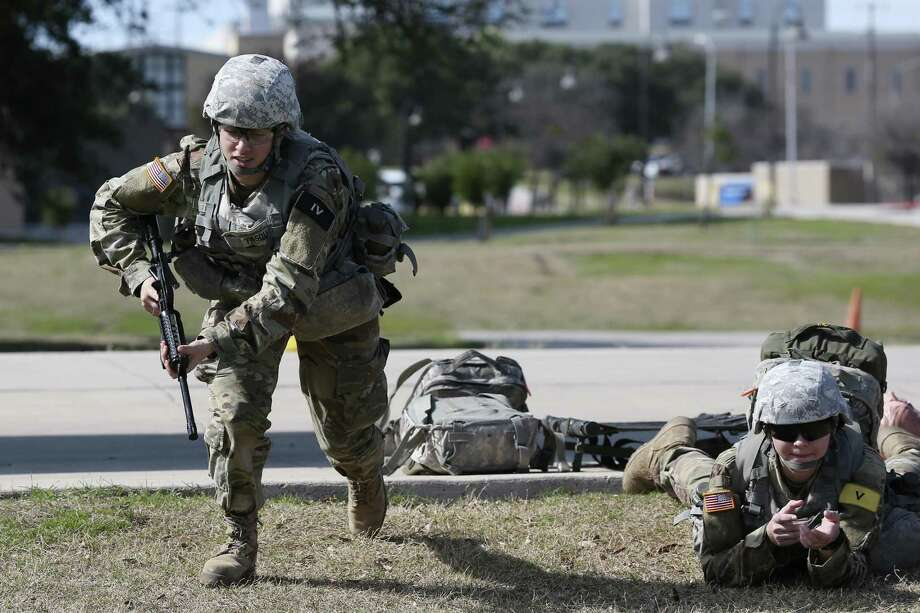 "U.S. Army medics in training Pvt. Andrea Pasquarelli, left, 19, of Keen, New Hampshire and Pvt. 2 Lillias Rodriguez, 19, of San Antonio, go through an exercise at Joint Base San Antonio-Fort Sam Houston, Tuesday, Jan. 24, 2017. Former President Obama's initiative to open up the last combat specialties that have long been closed to women could be jeopardy now that retired Marine Gen. James ""Mad Dog"" Mattis is likely to become the next defense secretary under President-elect Donald Trump. One sign of where things are headed: Gen. Robert Neller, the Marine Corps commandant, has signaled that he is ready to implement any changes to the Obama edict that Trump's administration hands down. Photo: JERRY LARA, Staff / San Antonio Express-News / © 2017 San Antonio Express-News"
