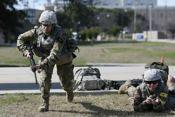 "U.S. Army medics in training Pvt. Andrea Pasquarelli, left, 19, of Keen, New Hampshire and Pvt. 2 Lillias Rodriguez, 19, of San Antonio, go through an exercise at Joint Base San Antonio-Fort Sam Houston, Tuesday, Jan. 24, 2017. Former President Obama's initiative to open up the last combat specialties that have long been closed to women could be jeopardy now that retired Marine Gen. James ""Mad Dog"" Mattis is likely to become the next defense secretary under President-elect Donald Trump. One sign of where things are headed: Gen. Robert Neller, the Marine Corps commandant, has signaled that he is ready to implement any changes to the Obama edict that Trump's administration hands down."