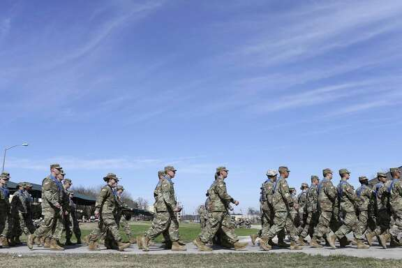 """Soldiers march in formation during training at Joint Base San Antonio-Fort Sam Houston, Tuesday, Jan. 24, 2017. Former President Obama's initiative to open up the last combat specialties that have long been closed to women could be jeopardy now that retired Marine Gen. James """"Mad Dog"""" Mattis is likely to become the next defense secretary under President-elect Donald Trump. One sign of where things are headed: Gen. Robert Neller, the Marine Corps commandant, has signaled that he is ready to implement any changes to the Obama edict that Trump's administration hands down."""