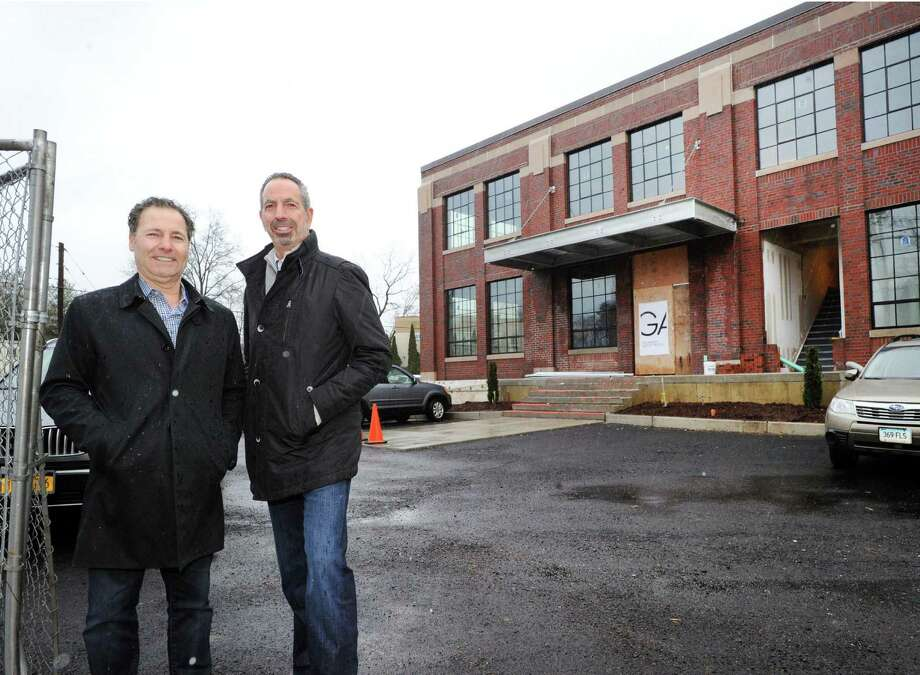 Richard Granoff, left, of Granoff Architects and partner Jeffrey Mendell in front of the former Connecticut Light & Power building at 330 Railroad Ave., Greenwich, Conn., Tuesday, Jan. 24, 2017. Granoff and Mendell bought the 3-story buidling that was built in 1928. After renovations, there will be 25,000-square-feet of business space and will be classified as a Class A office building. It will be the new home of Granoff Architects and will also house other tenants. Photo: Bob Luckey Jr. / Hearst Connecticut Media / Greenwich Time