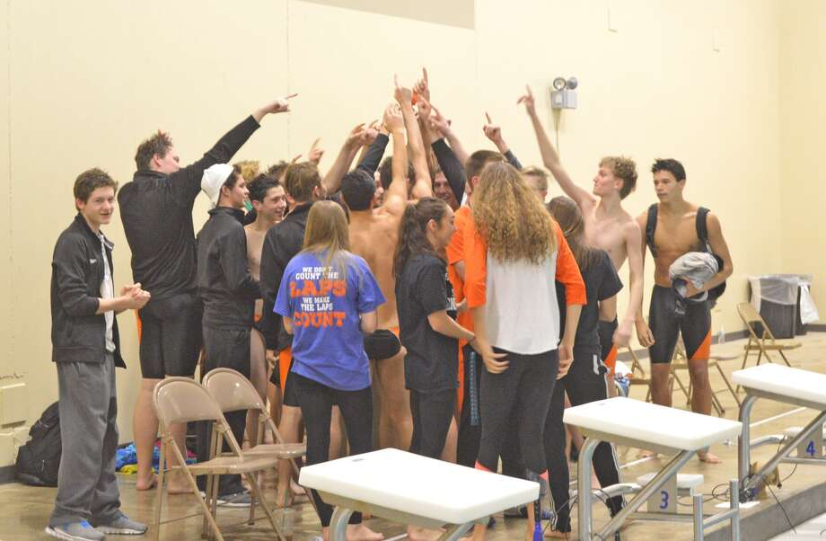 Members of the Edwardsville boys' swim team celebrate Saturday's 93-91 victory over Springfield at Chuck Fruit Aquatic Center. The Senior Day win gave the Tigers an 8-0 record in dual meets.