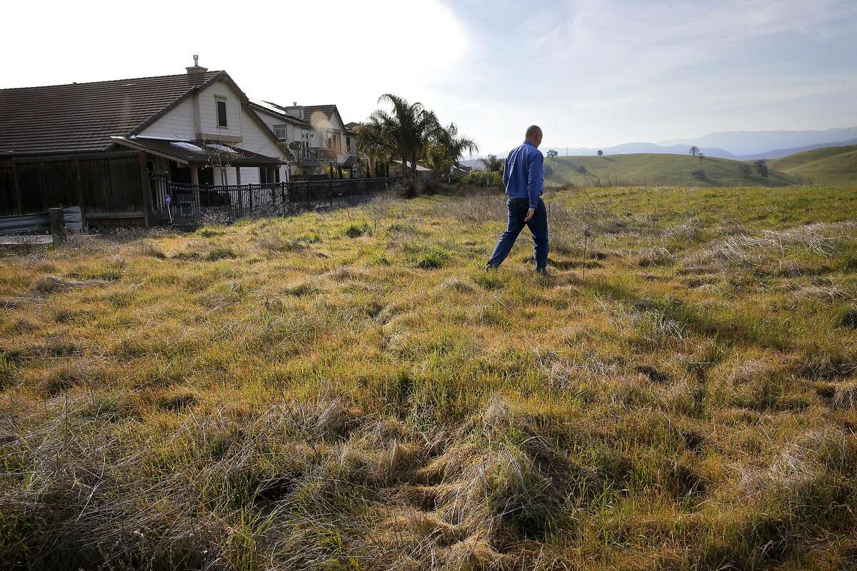 Jeremy Madsen, CEO of Greenbelt Alliance walks through open space near Mesa Oakes court which is at risk of future development in Brentwood, Ca., as seen on Monday Jan. 30, 2017. With a lack of housing has left hundreds of thousands of acres of Bay Area open space, from ranches in Antioch to scenic landscapes in San Mateo are in danger of being developed, a report that will be released Tuesday reveals.