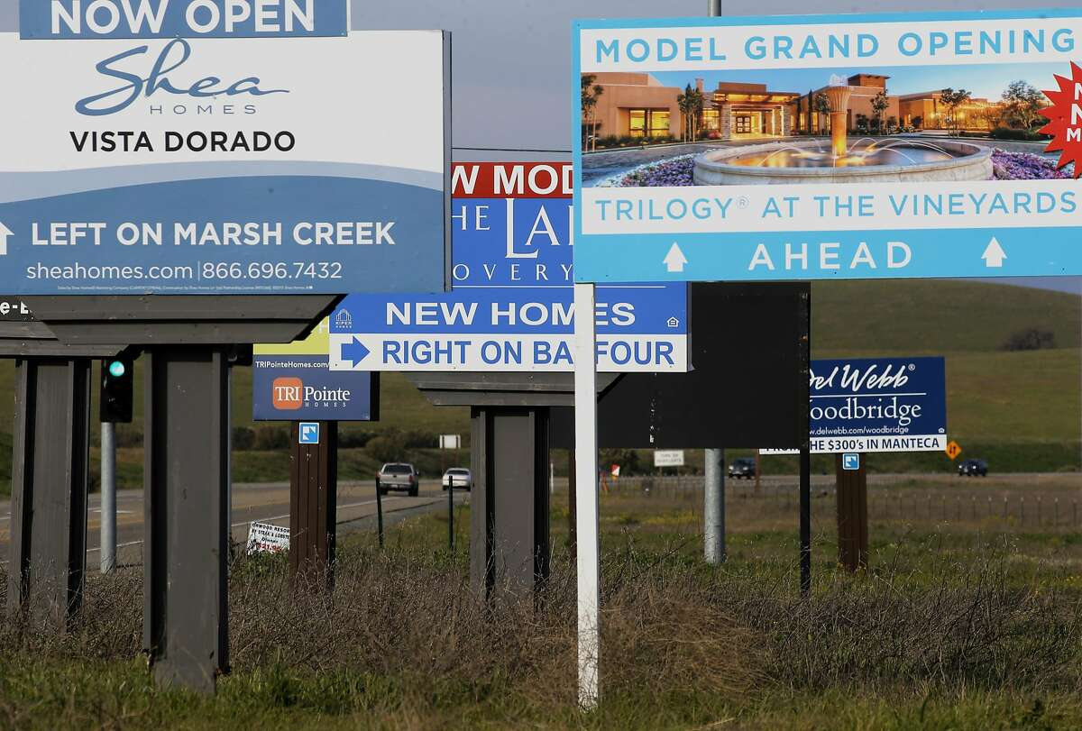 New housing billboards line highway 4 in eastern Contra Costa County near Brentwood, Ca., as seen on Monday Jan. 30, 2017. With a lack of housing has left hundreds of thousands of acres of Bay Area open space, from ranches in Antioch to scenic landscapes in San Mateo are in danger of being developed.