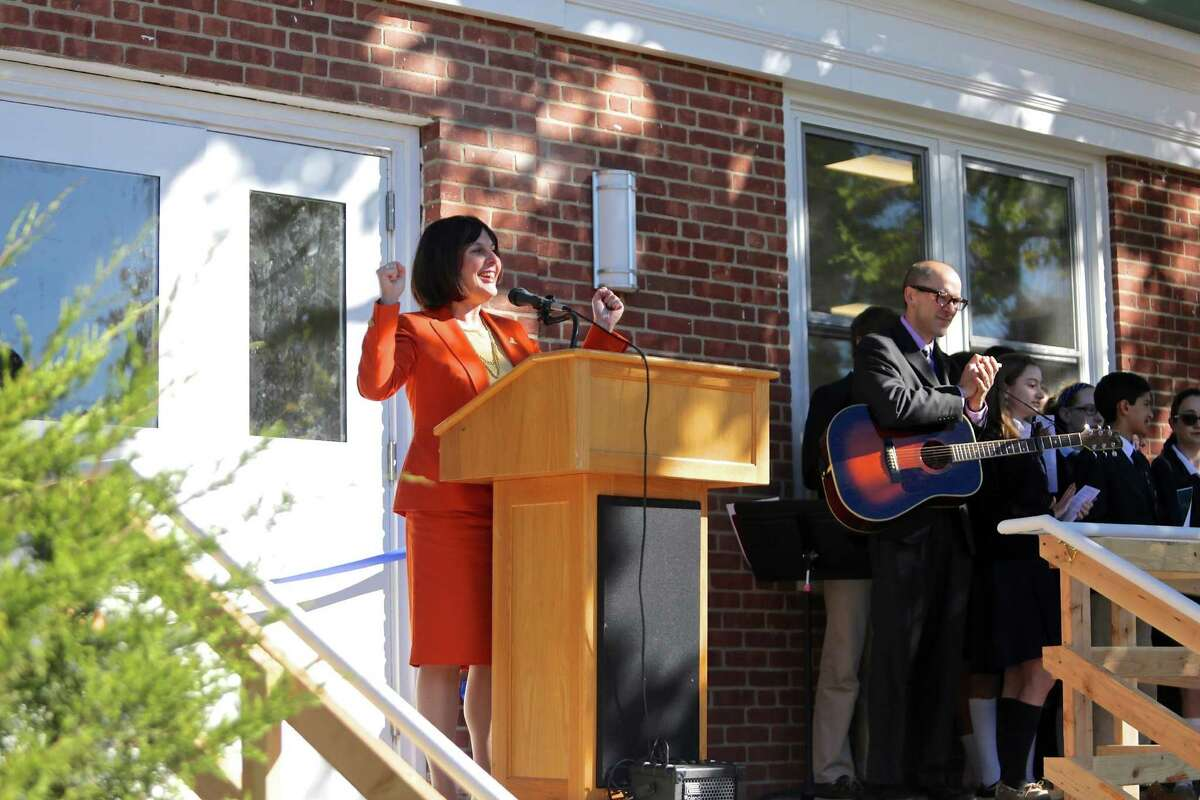 Principal Patrice Kopas welcomes the crowd during a ribbon cutting ceremony for the new Upper School at Greenwich Catholic School October 11, 2016. Unlike many other Catholic schools in the area, Greenwich's school is thriving.