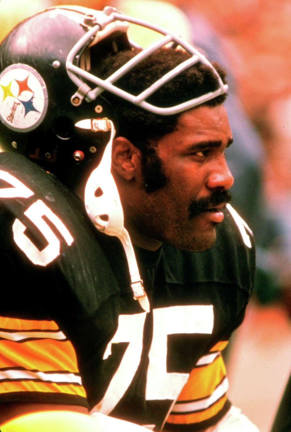 Defensive tackle Joe Greene of the Pittsburgh Steelers takes a rest in a 1970 game. é'ÂNFLP/NFL Photos HOUCHRON CAPTION (01/30/04): Joe Greene. SPECIAL SECTION: SUPER BOWL XXXVIII 2 DAYS TO KICKOFF.
