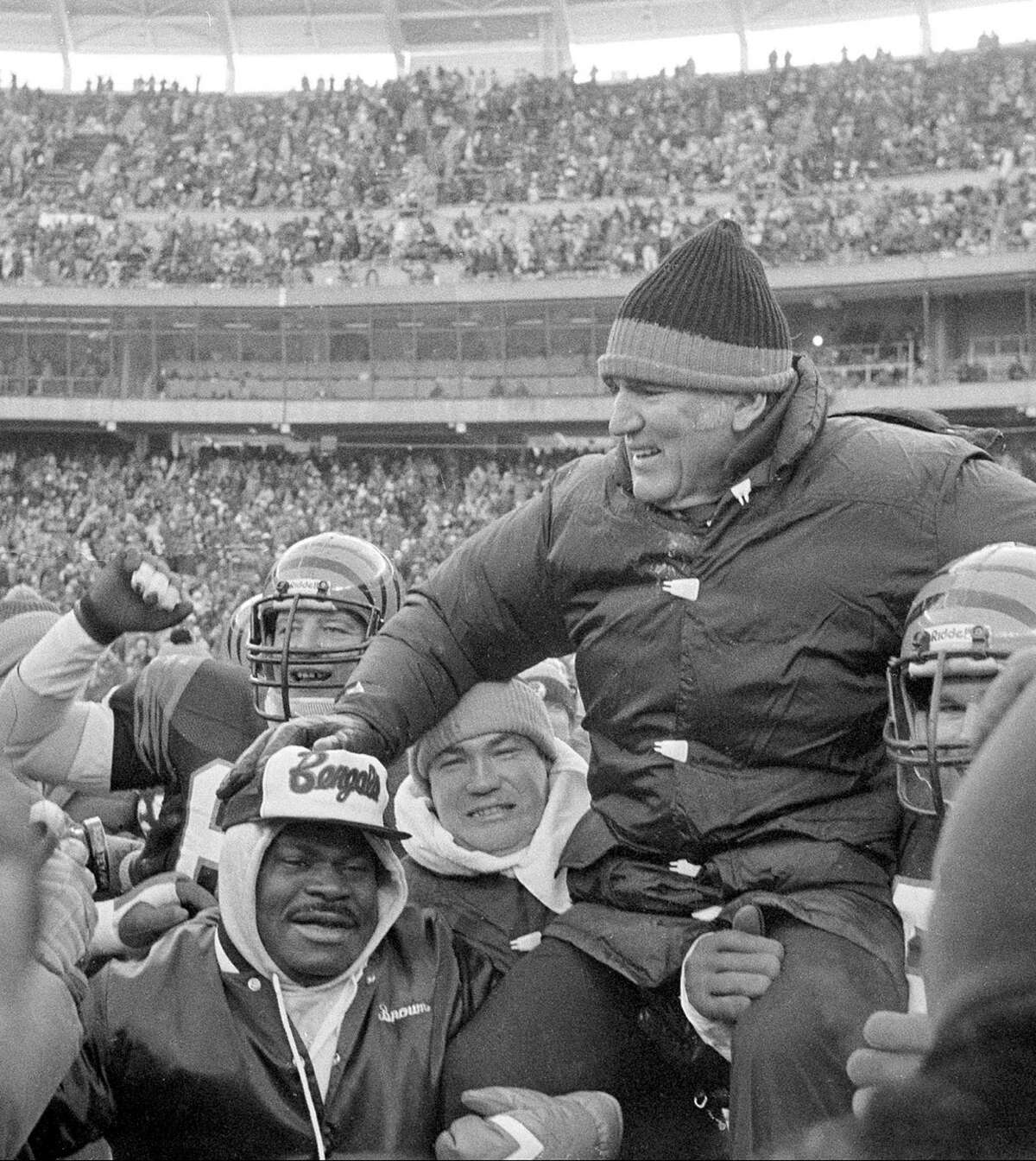 Cincinnati Bengals coach Forrest Gregg is carried off the field by jubilant players and fans after the Bengals defeated the San Diego Chargers in the AFC Championship playoff game in Cincinnati, Ohio, Jan. 10, 1982. The win gives the Bengals their first Super Bowl position. (AP Photo)