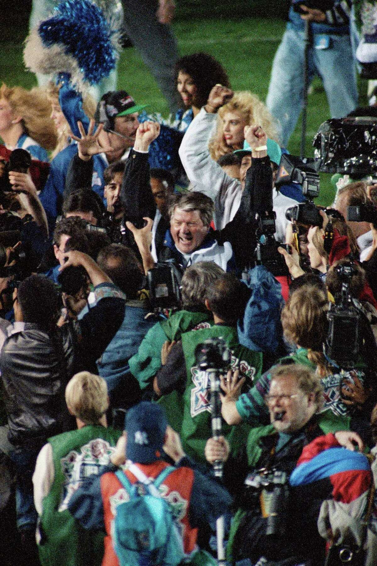 Dallas Cowboy coach Jimmy Johnson raises his arms in celebration after his team's 52-17 victory over the Buffalo Bill in the Super Bowl, Sunday, Jan. 31, 1993 in Pasadena. (AP Photo/Doug Pizac)