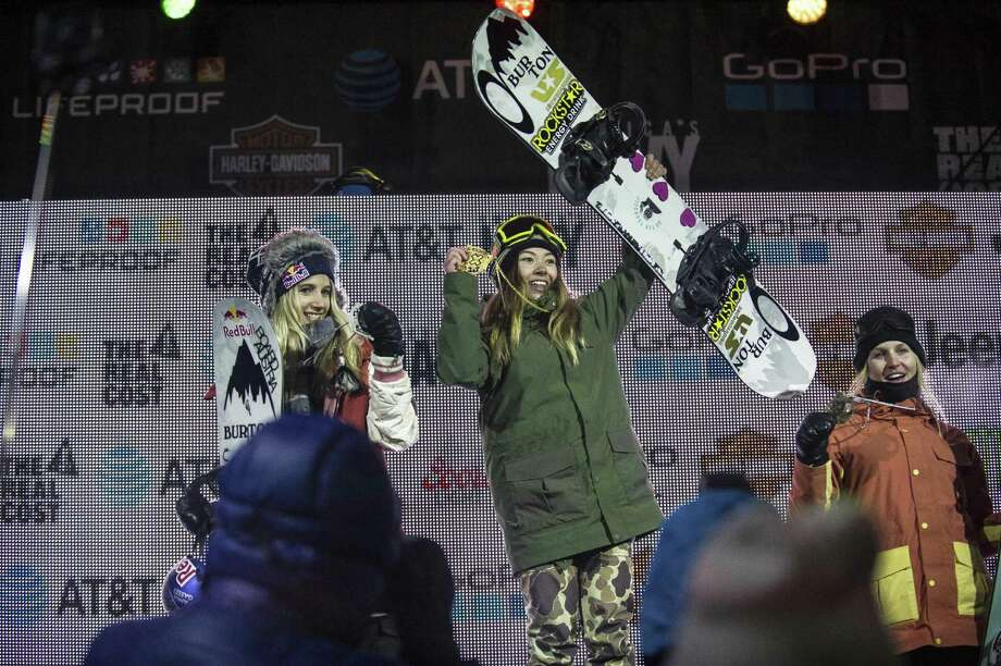 California teen Hailey Langland, center, stands on the podium at Buttermilk Ski Area in first place after competing in the women's big air final Thursday, Jan. 26, 2017, just north of Aspen, Colo. Anna Gasser, left, came in second place, while Julia Marino took 3rd place.  (Anna Stonehouse/The Aspen Times via AP) Photo: Anna Stonehouse / Associated Press / The Aspen Times