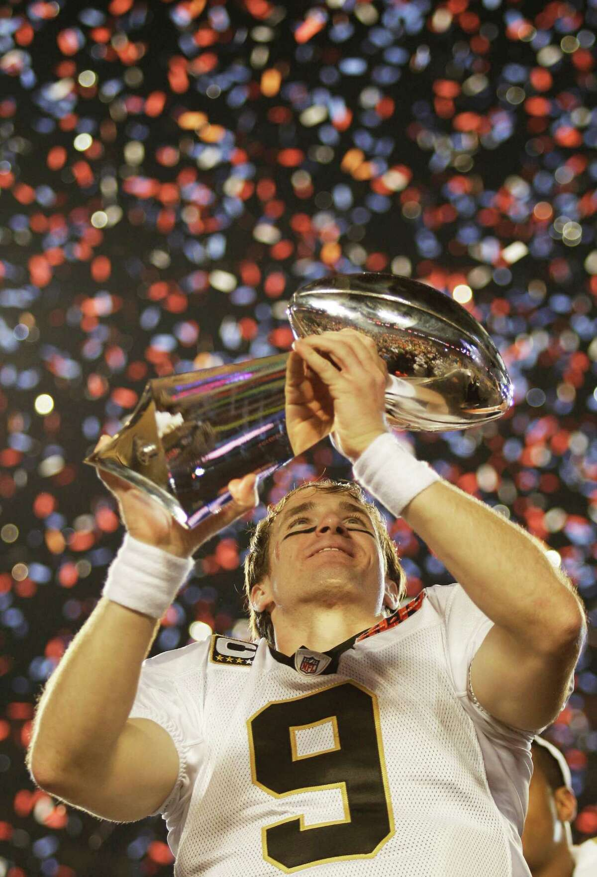 FILE - This Feb. 7, 2010, file photo shows New Orleans Saints quarterback Drew Brees holding the Vince Lombardi Trophy after the NFL Super Bowl XLIV football game against the Indianapolis Colts, in Miami. Brees was voted the 2010 Male Athlete of the Year, chosen by members of The Associated Press, Friday, Dec. 17, 2010. (AP Photo/David J. Phillip, File)