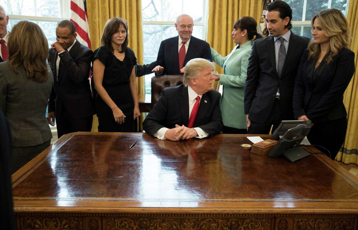 President Donald Trump during the signing of an executive action to cut regulations for small businesses, while surrounded by small business leaders in the Oval Office of the White House in Washington, Jan. 30, 2017. (Stephen Crowley/The New York Times)