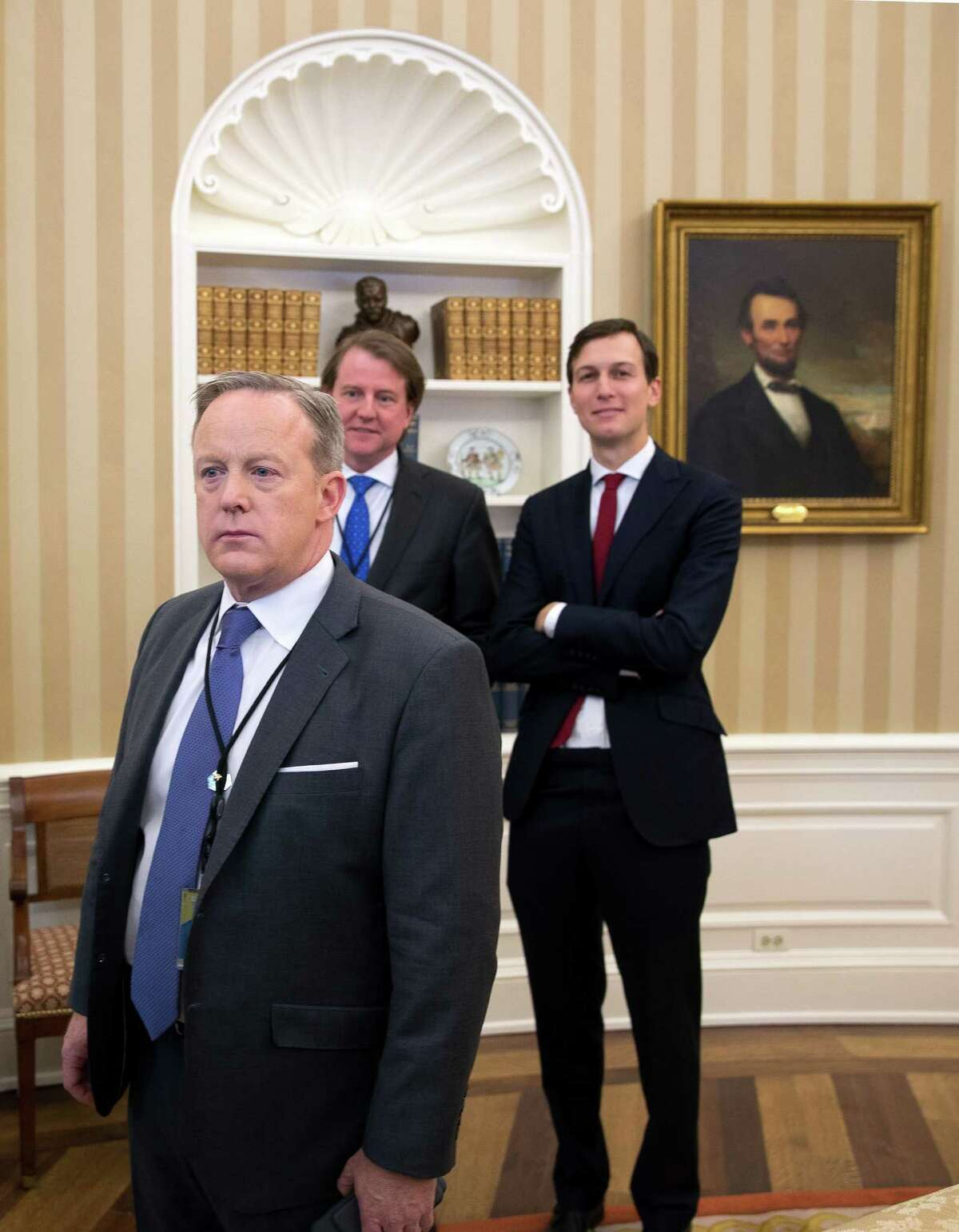 White House Press Secretary Sean Spicer, left, during a singing of an executive action to cut regulations for small businesses with small business leaders in the Oval Office of the White House in Washington, Jan. 30, 2017. (Stephen Crowley/The New York Times)