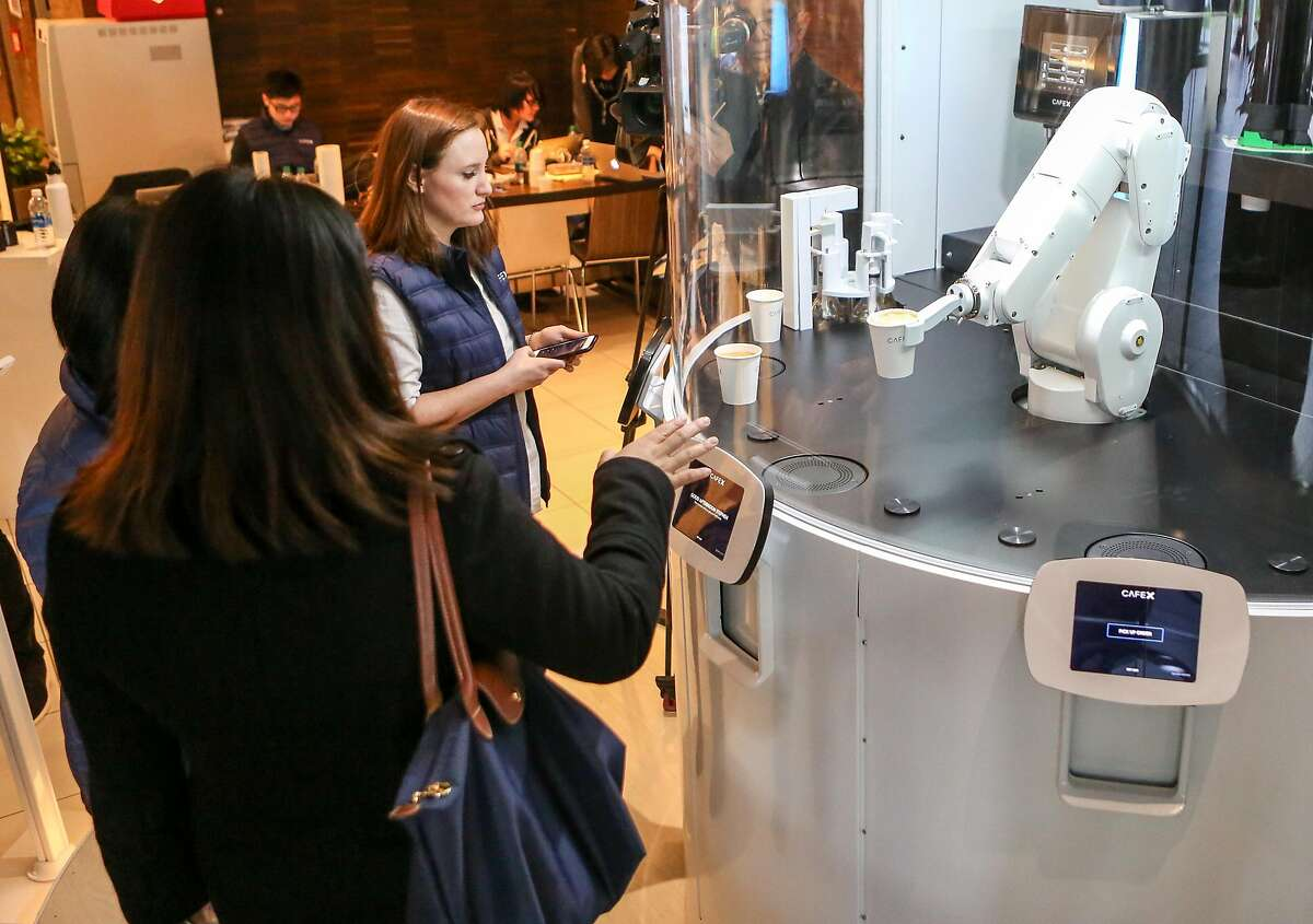 Customers try out the new robotic cafe, Cafe X, located within the Metreon in San Francisco, Calif. on Monday, January 30, 2017.