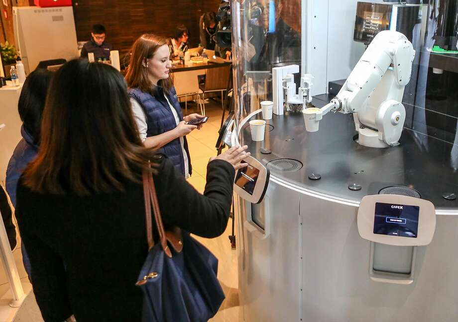 Customers try out the new robotic cafe, Cafe X, located within the Metreon in San Francisco, Calif. on Monday, January 30, 2017. Photo: Amy Osborne, Special To The Chronicle