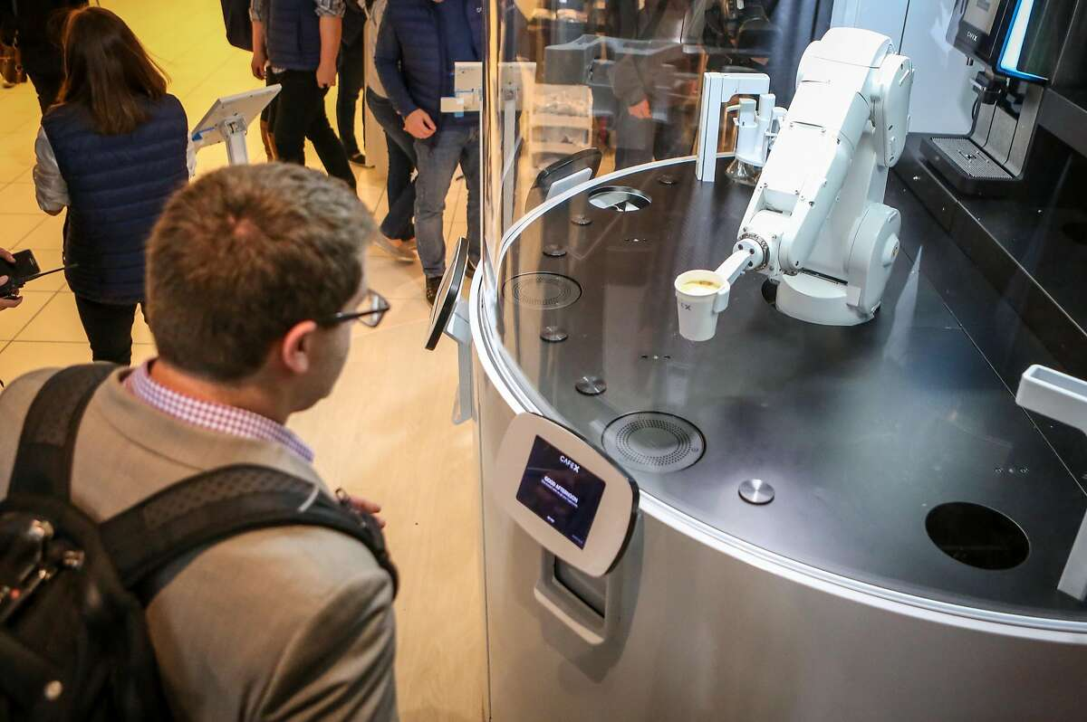 Nir Katchinskiy waits as the new robotic arm at Cafe X, the first robotic cafe, serves him his drink in San Francisco, Calif. on Monday, January 30, 2017.