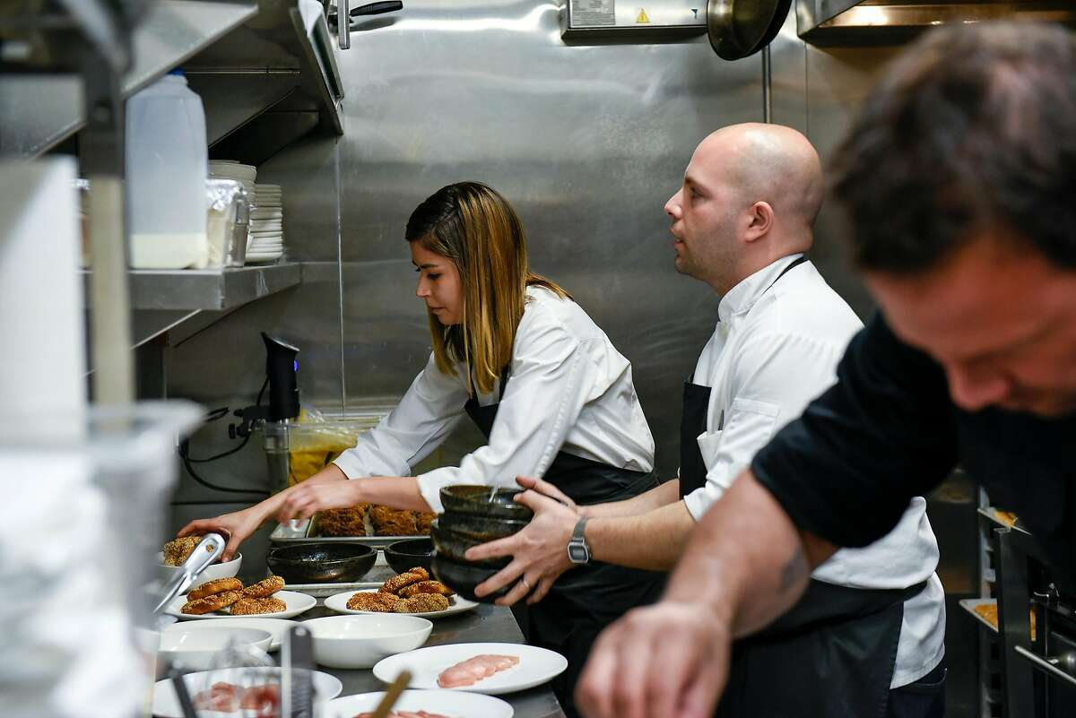 """Husband and wife chef team Laura and Sayat Ozyilmaz work in the kitchen during their pop-up restaurant """"Istanbul Modern"""" in San Francisco, CA on Sunday, January 29, 2017."""