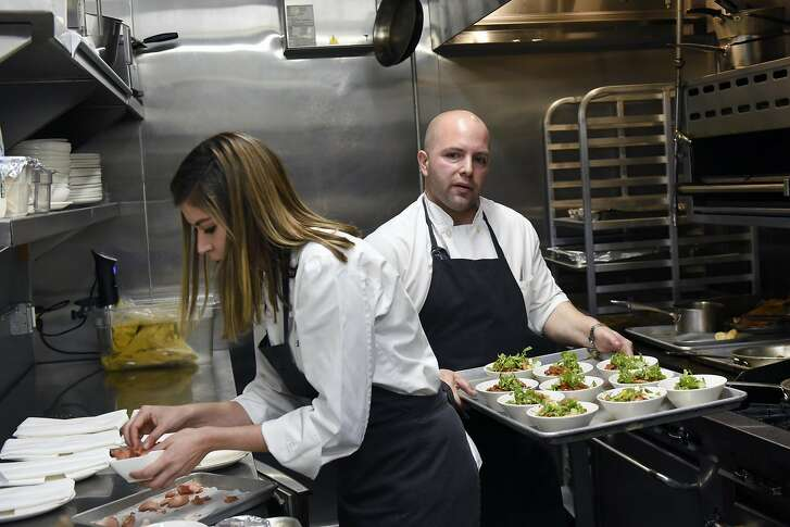 "Husband and wife chef team Laura and Sayat Ozyilmaz work in the kitchen during their pop-up restaurant ""Istanbul Modern"" in San Francisco, CA on Sunday, January 29, 2017."