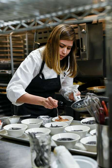 Chef Laura Ozyilmaz plates dishes at the Istanbul Modern pop-up she and her husband run in S.F. Photo: Michael Short, Special To The Chronicle