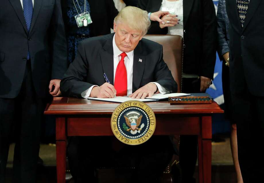 President Donald Trump signs an executive order for border security and immigration enforcement improvements on Jan. 25, 2017, at the Homeland Security Department in Washington. (AP Photo/Pablo Martinez Monsivais) Photo: Pablo Martinez Monsivais, STF / Copyright 2017 The Associated Press. All rights reserved.