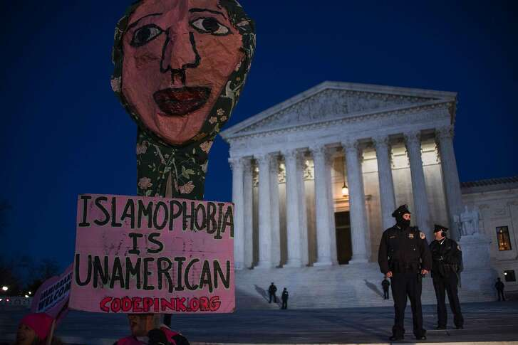 Demonstrators gather outside the US Supreme Court demanding US President Donald Trump reverse hateful anti-refugee and anti-immigration executive orders in Washington, DC, January 30, 2017. / AFP PHOTO / JIM WATSONJIM WATSON/AFP/Getty Images
