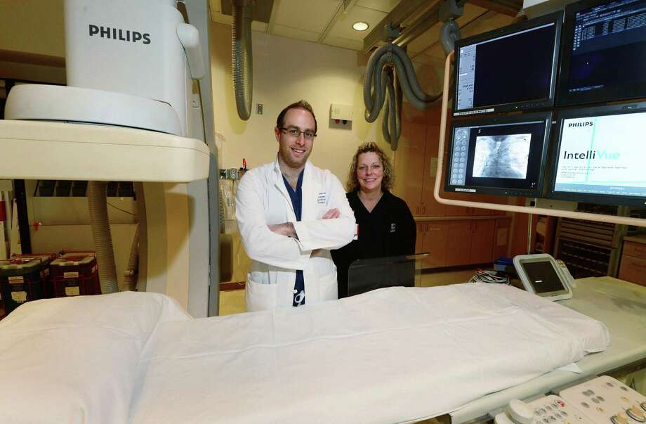 Neurosurgeon Dr. Joshua Marcus and Stroke Coordinator and Rapid Response Nurse Michelle Lecardo of the Endovascular Stroke Team Thursday, january 19, 2017 at Norwalk Hospital in Norwalk, Conn. The team successfully performed the first endovascular stroke procedure, an intra-arterial mechanical thrombectomy treatment for ischemic stroke. No other facility in the area offers this cutting-edge, minimally invasive treatment in the emergency management of patients with acute strokes. Photo: Erik Trautmann / Hearst Connecticut Media / Norwalk Hour