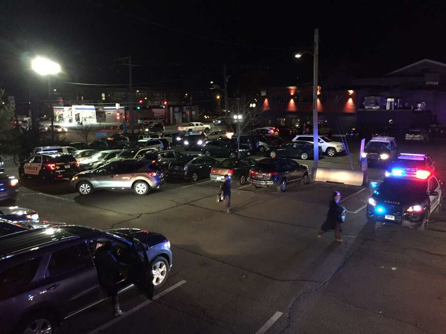 Police vehicles at the East Norwalk train station after a fight on a northbound train Monday night. Photo: Contributed / Elizabeth Ganga